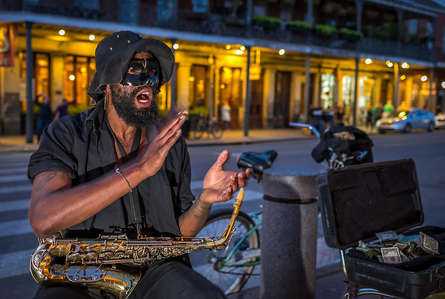 NEW ORLEANS - CIRCA FEBRUARY 2014: Street musician performing in the streets of New Orleans in Louisiana at night