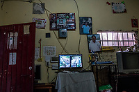 A screen showing the surveillance system around the home of Jorge Sanchez Ordonez, son of murdered journalist Jose Moises Sanchez Cerezo, (pictured on the wall) who was kidnapped in 2015, on January 2, 2015, and later found murdered, on June 29, 2016 in Veracruz, Mexico. On January 2, 2015, Mexican social activist and journalist Mois&eacute;s S&aacute;nchez Cerezo was kidnapped from his home in Medell&iacute;n de Bravo, Veracruz, Mexico and killed. According to eyewitness reports, armed men dressed in civilian clothing broke into his house and forced him into a vehicle. The kidnappers also took S&aacute;nchez's computer, camera, and cellphones. S&aacute;nchez was the founder and director of the weekly newspaper La Uni&oacute;n, (&quot;The Union&quot;), where he covered a varierty of topics, including political corruption, government mismanagement, and organized crime. He was also active on social media as a reporter, and in his community as a taxi driver, small business owner, and neighborhood organizer. His family initially suspected that the mayor of Medell&iacute;n de Bravo, Omar Cruz Reyes, was responsible for masterminding the kidnapping because S&aacute;nchez was a harsh critic of his administration. The mayor, however, pledged his innocence and stated that S&aacute;nchez and him maintained a close friendship. On January 24, his corpse was discovered inside a plastic bag in Manlio Fabio Altamirano, Veracruz. Post-mortem examinations confirmed that his kidnappers cut his throat open and severed his head while he was still alive before mutilating his body into several pieces. Investigators believe that municipal policemen, acting on orders of the mayor, participated in the murder. S&aacute;nchez was the first journalist kidnapped and killed in Mexico in 2015.<br /> Photo Daniel Berehulak for the New York Times