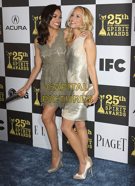 ROSARIO DAWSON & MARIA BELLO .25th Annual Film Independent Spirit Awards held At The Nokia LA Live, Los Angeles, California, USA,.March 5th, 2010 ..arrivals Indie Spirit full length gold  nude beige cream one shoulder shiny green lace dress peep toe shoes grey gray clutch bag  .CAP/ADM/KB.©Kevan Brooks/Admedia/Capital Pictures