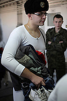 A new conscript waits to hand in his belongings. This year's class of drafted recruits is the final one after 90 years of compulsory military service, as Poland's army turns professional in 2009.