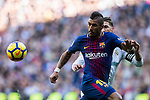 Jose Paulo Bezerra Maciel Junior, Paulinho (L), of FC Barcelona fights for the ball with Sergio Ramos of Real Madrid during the La Liga 2017-18 match between Real Madrid and FC Barcelona at Santiago Bernabeu Stadium on December 23 2017 in Madrid, Spain. Photo by Diego Gonzalez / Power Sport Images
