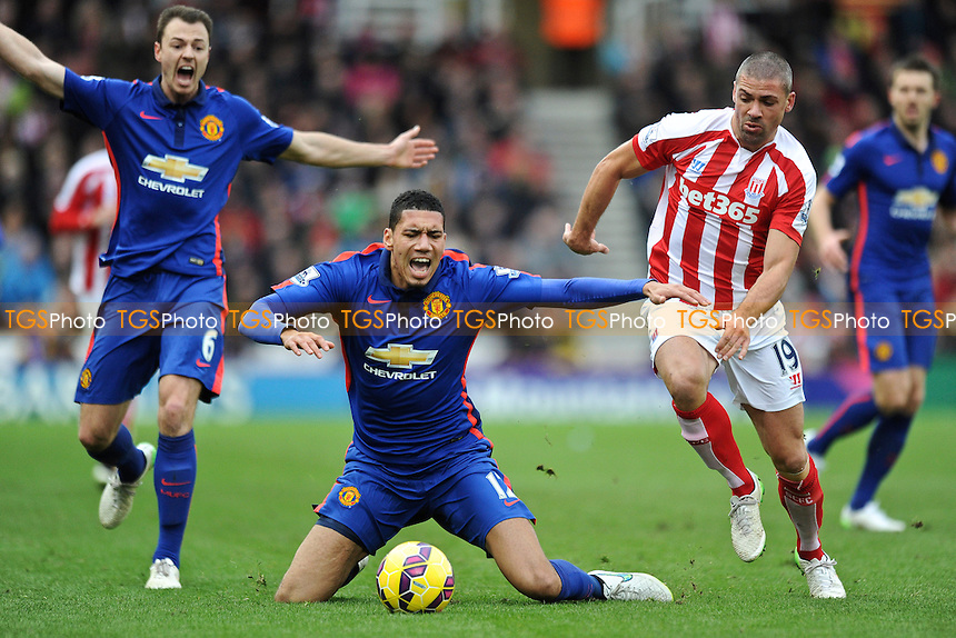 Chris Smalling of Manchester United is fouled by Jonathan Walters of Stoke City - Stoke City vs Manchester United - Barclays Premier League Football at the Britannia Stadium, Stoke-on-Trent - 01/01/15 - MANDATORY CREDIT: Greig Bertram/TGSPHOTO - Self billing applies where appropriate - contact@tgsphoto.co.uk - NO UNPAID USE