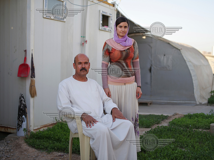 A Yazidi couple, Ali 51, and his wife Shami, 40, living in a IDP camp in Dohuk. 'When I was living in Dogre village in Sinjar, I was a farmer and was growing eggplant, potatoes, tomatoes, okra etc. Now, I am living in this camp and have started growing flowers, celery etc in front of my tent.'