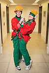© Joel Goodman - 07973 332324 . 7 December 2013 . Boyfriend and girlfriend Justin Blackhurst (31 from Stockport) and Carla Whale (27 from Hale Barnes) (both correct) dressed as elves - prior to their descent - they have elf and safety concerns . In scenes reminiscent of a Fathers for Justice demonstration , people in superhero and Christmas-themed costumes , abseil 107 metres down the New York Street side of City Tower to raise money for the Factory Youth Zone in Harpurhey . Photo credit : Joel Goodman