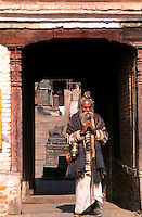 Religious man with wonderful character going into temple in Kathmandu Nepal Katmandu