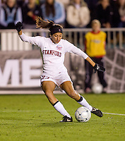Christen Press (23) of Stanford takes a shot during the second game of the NCAA Women's College Cup at WakeMed Soccer Park in Cary, NC.  Stanford defeated Boston College, 2-0.