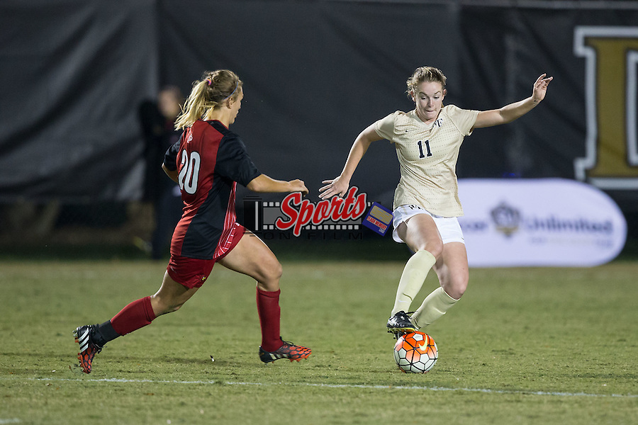 Maddie Huster (11) of the Wake Forest Demon Deacons keeps the ball away from Alison Price (20) of the Louisville Cardinals during second half action at Spry Soccer Stadium on October 31, 2015 in Winston-Salem, North Carolina.  The Demon Deacons defeated the Cardinals 2-1.  (Brian Westerholt/Sports On Film)