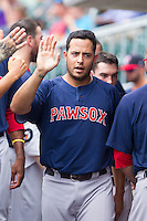 Carlos Rivero (24) of the Pawtucket Red Sox high fives teammates after scoring a run against the Charlotte Knights at BB&T Ballpark on August 8, 2014 in Charlotte, North Carolina.  The Red Sox defeated the Knights  11-8.  (Brian Westerholt/Four Seam Images)