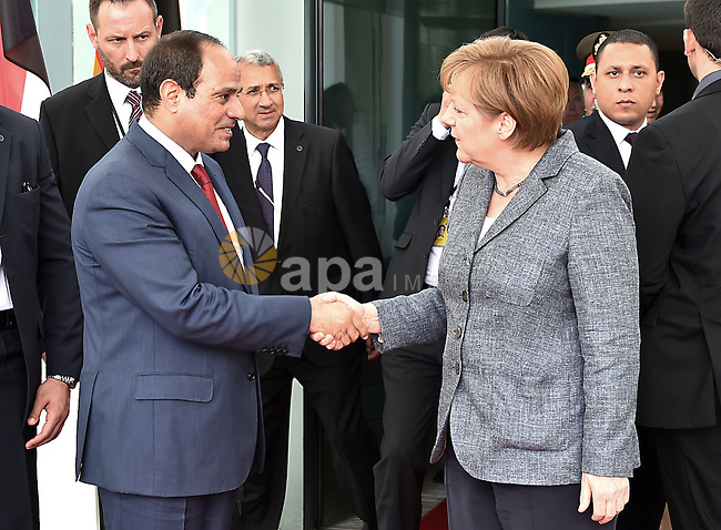 German Chancellor Angela Merkel and Egyptian President Abdel Fattah al-Sisi shake hands before a press conference on June 3, 2015 at the Chancellery in Berlin. Photo by Egyptian Presidency