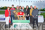 PRESENTATION: Peter O'Regan owner of Oak Care no.3 winner of the Barry Packing Hospital Sweep Final being presented with the winners trophy by Eddie Barry (Barry Packing) at the Kingdom Greyhound Stadium on Saturday l-r: Mary O'Regan, Shane O'Regan, Peter O'Regan, John Barry (Barry Packing, Eddie Barry (Barry Packing), Joanne Moriarty, Michael O'Regan and Tom O'Connor (chairman Friends of Kerry General Hospital).