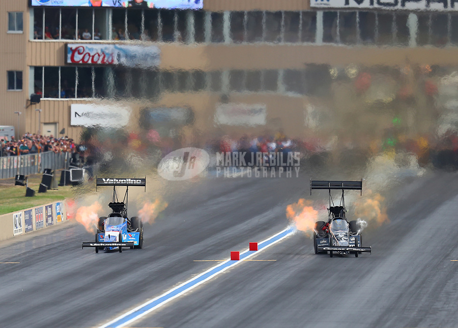 Jul 22, 2017; Morrison, CO, USA; NHRA top fuel driver Clay Millican (right) alongside XXXX during qualifying for the Mile High Nationals at Bandimere Speedway. Mandatory Credit: Mark J. Rebilas-USA TODAY Sports