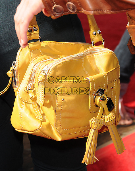 MISCHA BARTON's bag .at the Make-a-Wish Foundation Funday at The Santa Monica Pier in Santa Monica, California, USA, .March 14th, 2010                                                                    .detail yellow bag tassels .CAP/RKE/DVS.©DVS/RockinExposures/Capital Pictures