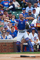 Chicago Cubs catcher David Ross (3) throws to first during a game against the Milwaukee Brewers on August 13, 2015 at Wrigley Field in Chicago, Illinois.  Chicago defeated Milwaukee 9-2.  (Mike Janes/Four Seam Images)