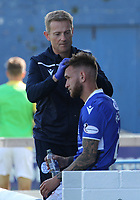 Scott Mercer gets treatment for a head wound in the SPFL Betfred League Cup group match between Queen of the South and Motherwell at Palmerston Park, Dumfries on 13.7.19.