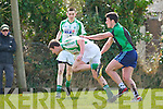 Na Gaeil's Owen Doody get away from Churchill's Benny Dillon in the Junior Club Football Championship at The Spa on Sunday.