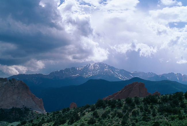 An afternoon storm surrounds Pikes Peak, near Colorado Springs, CO