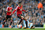 Martin Demichelis of Manchester City clears the ball ahead of Jesse Lingard of Manchester United during the Barclays Premier League match at the Etihad Stadium. Photo credit should read: Philip Oldham/Sportimage