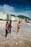 BRAZIL, Rio de Janiero, several swimmers preparing to enter the water at Copacabana Beach