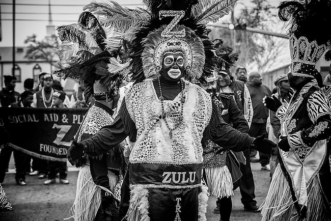 A Zulu Tramp and member of the Zulu Social Aid & Pleasure Club prepares to march in the 'Zulu Parade' on Jackson Avenue, the first parade on the morning of Mardi Gras Day on February 12, 2013 in New Orleans, Louisiana.