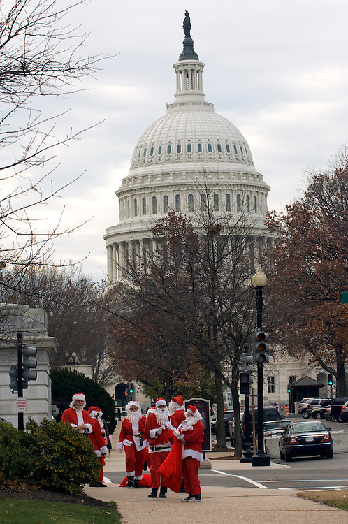 Large numbers of Santa's or Santa's helpers where out in force Wednesday morning handing out lumps of coal to Hill staffers on their way to work near the Upper Senate Park. The PR stunt was sponcered by the Americans for Balanced Energy Choices and the stockings they where handing out had a press release saying that getting coal in your stocking is a good thing. Attached to the press release was candy wrapped in black foil to look like coal.
