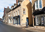 Shops and homes in historic buildings, Malmesbury, Wiltshire England, UK