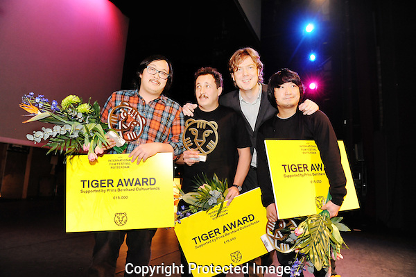 The Netherlands, Rotterdam, 4 february 2011. .International Film Festival Rotterdam 2011 .Winners Tiger Award Competition 2011.From left: Sivaroj Kongsakul, Sergio Caballero, festivaldirectot Rutger Wolfson and Park Jung-Bum.Photo by Nadine Maas Copyright and ownership by photographer. FOR IFFR USE ONLY. Not to be (re-)distributed in any form. Copyright and ownership by photographer. FOR IFFR USE ONLY. Not to be (re-)distributed in any form.