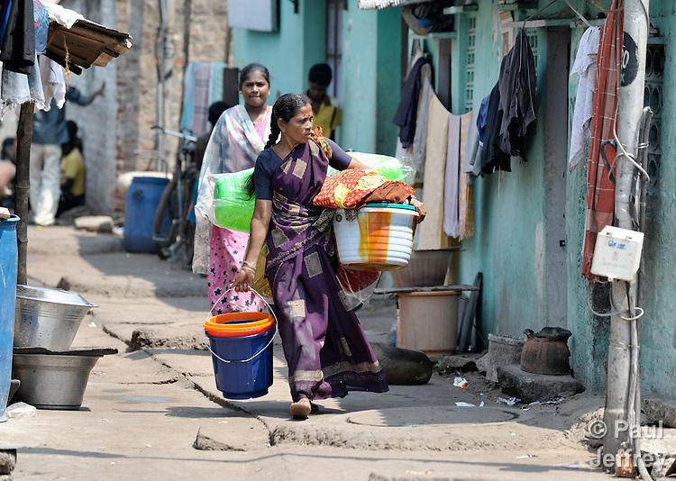 Women walk along a street in Chennai, India.
