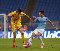 Calcio, Serie A: Lazio vs Frosinone. Roma, stadio Olimpico, 4 ottobre 2015.<br /> Frosinone's Daniel Ciofani, left, and Lazio's Danilo Cataldi fight for the ball during the Italian Serie A football match between Lazio and Frosinone at Rome's Olympic stadium, 4 October 2015.<br /> UPDATE IMAGES PRESS/Isabella Bonotto