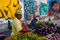 A Colombian vendor sells vegetables on the street of Getsemaní, a popular artistic neighborhood in Cartagena, Colombia, 16 December 2017. With the peace agreement, ending a 52-year civil conflict and promising political stability, together with rapid economic growth and unexploited tourism potential, Colombia has truly become a holiday destination. Cartagena, a UNESCO World Heritage site on the tropical Caribbean coast, plays the primary role in Colombia's tourism renaissance. The historic sites from the Spanish colonial times are being restored, private investments are visible throughout the city and an increased number of local people benefit from the boom of the travel related services.