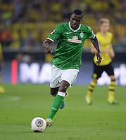 FUSSBALL  1. BUNDESLIGA  SAISON 2013/2014   3. SPIELTAG Borussia Dortmund - Werder Bremen                  23.08.2013 Assani Lukimya (SV Werder Bremen) Einzelaktion am Ball
