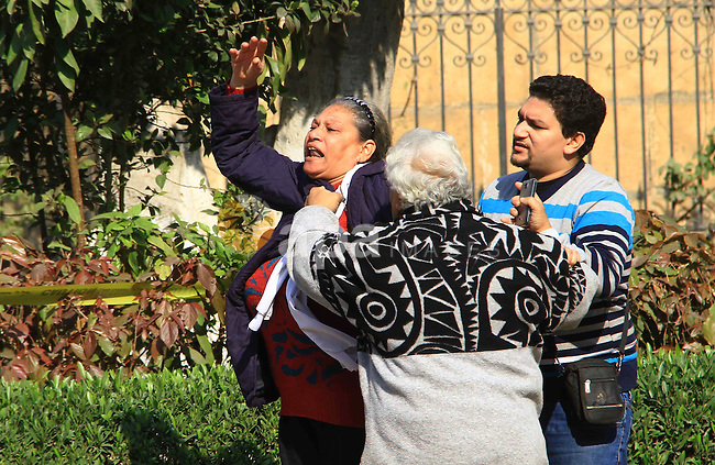 A relative of one of the blast victims reacts at the scene of a bomb explosion at the Saint Peter and Saint Paul Coptic Orthodox Church on December 11, 2016, in Cairo's Abbasiya neighbourhood. The blast killed at least 25 worshippers during Sunday mass inside the Cairo church near the seat of the Coptic pope who heads Egypt's Christian minority, state media said. Photo by Amr Sayed