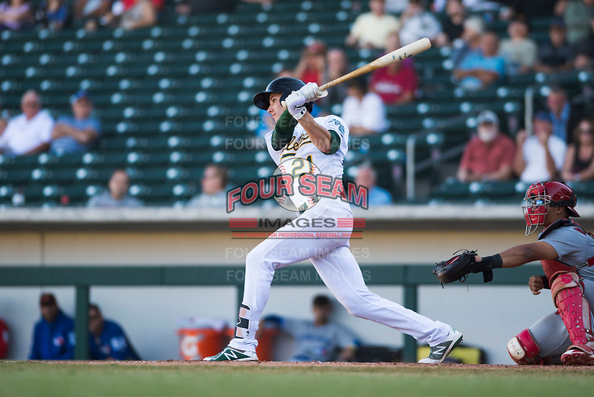 Mesa Solar Sox shortstop Eli White (21), of the Oakland Athletics organization, follows through on his swing during an Arizona Fall League game against the Surprise Saguaros at Sloan Park on November 1, 2018 in Mesa, Arizona. Surprise defeated Mesa 5-4 . (Zachary Lucy/Four Seam Images)