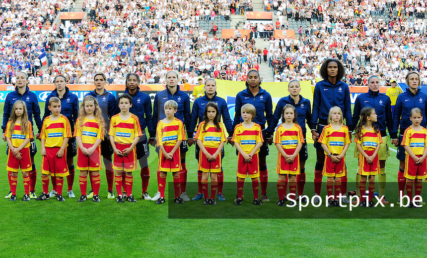 Fifa Women's World Cup Germany 2011 : France - Germany ( Frankrijk - Duitsland ) at Munchengladbach World Cup stadium : de franse ploeg bij de hymne.foto DAVID CATRY / Vrouwenteam.be