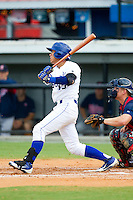 Pedro Gonzalez (13) of the Burlington Royals follows through on his swing against the Elizabethton Twins at Burlington Athletic Park on August 11, 2013 in Burlington, North Carolina.  The Twins defeated the Royals 12-5.  (Brian Westerholt/Four Seam Images)
