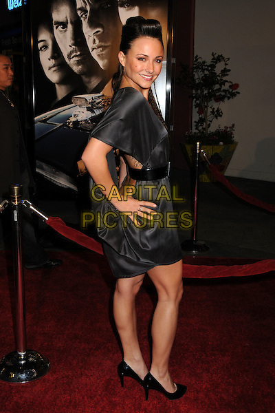 "BRIANA EVIGAN.""Fast & Furious"" Los Angeles Premiere at the Universal City Walk Gibson Amphitheatre, Universal City, California, USA..March 12th, 2009.full length black dress silk satin tattoo belt .CAP/ADM/BP.©Byron Purvis/AdMedia/Capital Pictures."