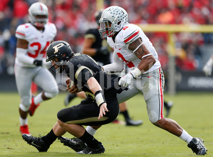 Purdue Boilermakers quarterback Danny Etling (5) is taken down by Ohio State Buckeyes linebacker Ryan Shazier (2) during Saturday's NCAA Division I football game at Ross-Ade Stadium in West Lafayette, In. on November 2, 2013. (Barbara J. Perenic/The Columbus Dispatch)