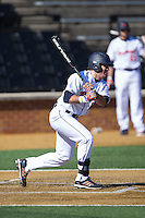 Danny Rafferty (4) of the Bucknell Bison follows through on his swing against the Georgetown Hoyas at Wake Forest Baseball Park on February 14, 2015 in Winston-Salem, North Carolina.  The Hoyas defeated the Bison 8-5.  (Brian Westerholt/Four Seam Images)
