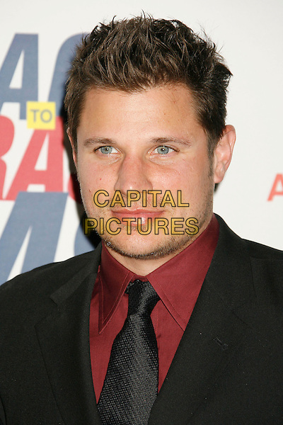 "NICK LACHEY.14th Annual Race to Erase MS Themed ""Dance to Erase MS"" held at the Century Plaza Hotel, Century City, California, USA, 13 April 2007..portrait headshot black tie suit red shirt.CAP/ADM/RE.©Russ Elliot/AdMedia/Capital Pictures."