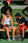 SURPRISE, AZ - MAY 11: Sonja Larsen of the Barry Buccaneers talk with head coach Avi Kigel while being iced down by a trainer before the resuming her match against Paula Coyos of the West Florida Argonauts during the Division II Women's Tennis Championship held at the Surprise Tennis & Racquet Club on May 11, 2018 in Surprise, Arizona. (Photo by Jack Dempsey/NCAA Photos via Getty Images)