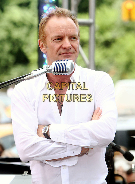 "STING (Gordon Matthew Thomas Sumner).Sting Performs On CBS' ""The Early Show"" held at the CBS Early Show Studio Plaza, New York, NY, USA..July 15th, 2010.stage concert live gig performance music half length white shirt arms crossed .CAP/ADM/AC.©Alex Cole/AdMedia/Capital Pictures."