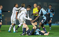 Anthony Stewart of Wycombe Wanderers protects floored teammate Luke O'Nien of Wycombe Wanderers from Alan Sheehan of Notts County during the Sky Bet League 2 match between Wycombe Wanderers and Notts County at Adams Park, High Wycombe, England on 15 December 2015. Photo by Andy Rowland.