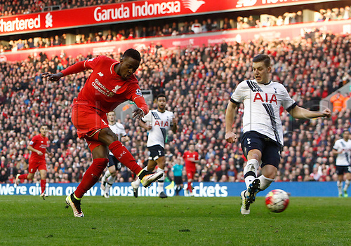 02.04.2016. Anfield, Liverpool, England. Barclays Premier League. Liverpool versus Tottenham Hotspur. Liverpool striker Divock Origi shoots as Spurs defender Kevin Wimmer challenges.