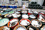 Sonae Fujii of the Zero Waste Academy in Kamikatsu stands next to containers filled with waste ready for recycling at the Hibigaya Waste Station in central KamikatsuTown in Shikoku, Japan.