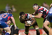 With Sean Bagshaw on his shoulder Fotu Lokotui makes a run from the back of a ruck. Mitre 10 Cup game between Counties Manukau Steelers and Tasman Mako's, played at ECOLight Stadium Pukekohe on Saturday October 14th 2017. Counties Manukau won the game 52 - 30 after trailing 22 - 19 at halftime. <br /> Photo by Richard Spranger.