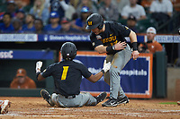Josh Holt Jr. (1) of the Missouri Tigers is greeted by teammate Blake Jackson (12) after scoring a run during the game against the Texas Longhorns in game eight of the 2020 Shriners Hospitals for Children College Classic at Minute Maid Park on March 1, 2020 in Houston, Texas. The Tigers defeated the Longhorns 9-8. (Brian Westerholt/Four Seam Images)