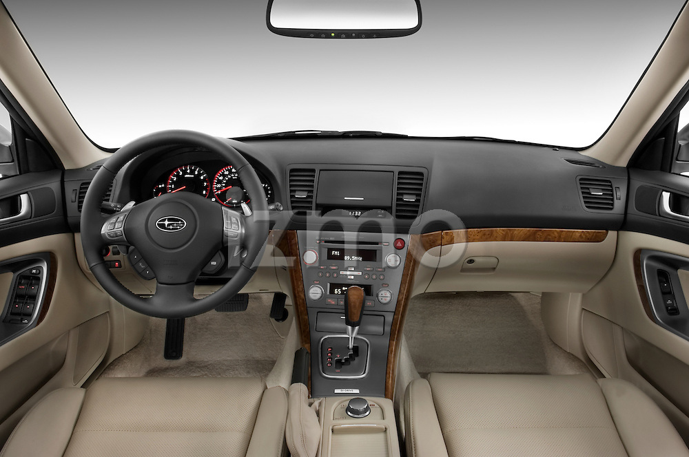 Straight dashboard view of a 2008 Subaru Legacy GT sedan.