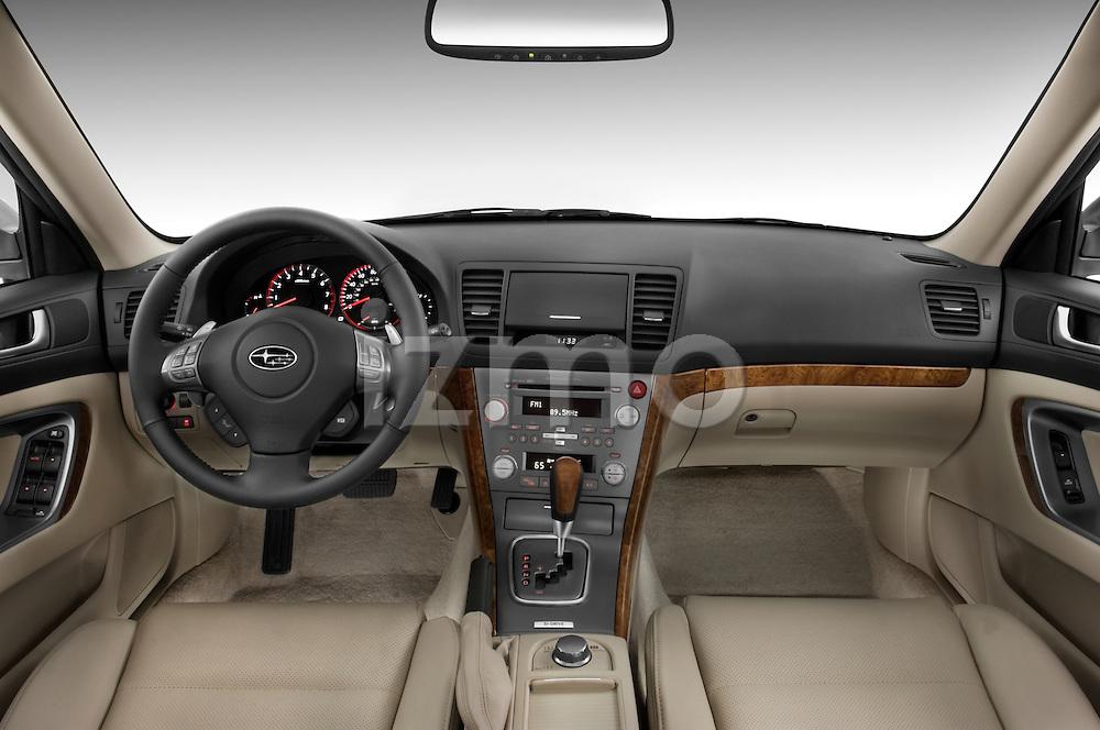 Straight dashboard view of a 2008 Subaru Legacy GT sedan.