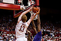 23 February 2011: Brandon Ubel #13 of the Nebraska Cornhuskers is blocked by the backboard and Rodney McGruder #22 of the Kansas State Wildcats during the second half at the Devaney Sports Center in Lincoln, Nebraska. Kansas State defeated Nebraska 61 to 57.