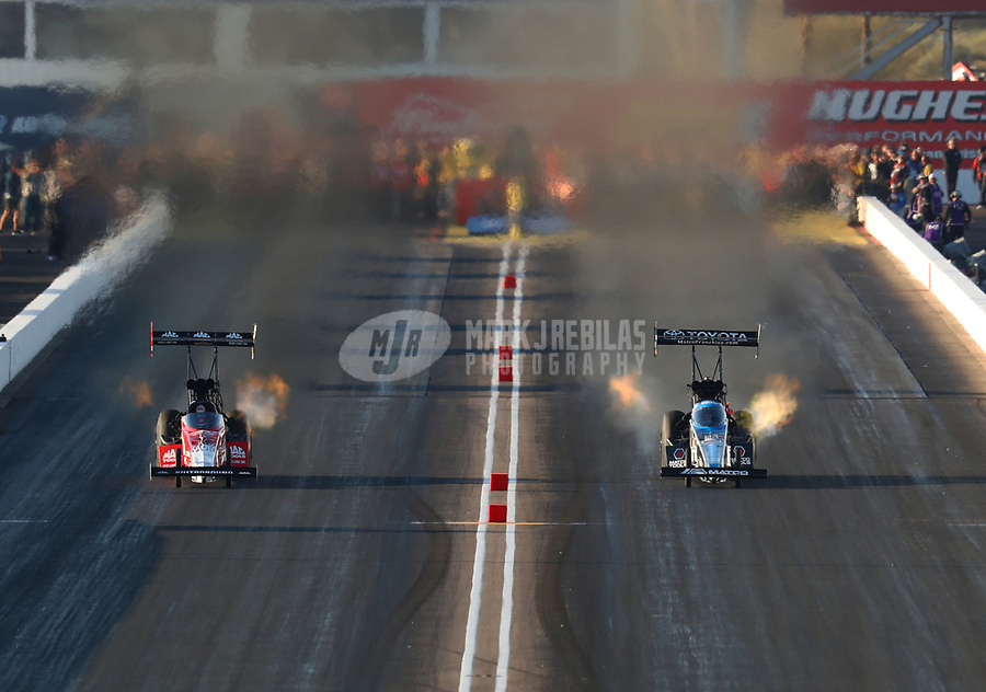 Feb 23, 2019; Chandler, AZ, USA; NHRA top fuel driver Antron Brown (right) alongside Doug Kalitta during qualifying for the Arizona Nationals at Wild Horse Pass Motorsports Park. Mandatory Credit: Mark J. Rebilas-USA TODAY Sports