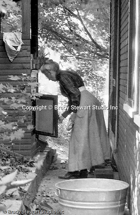North East PA:  View of Alice Brady Stewart getting ice from Ice box -  1919.  Ice box was located in the rear of the Lake Erie rental cabin.  This was the Stewart family's first Lake Erie vacation after Brady Stewart served his country during World War 1.  Stewart family rented a cabin on Lake Erie near North East.